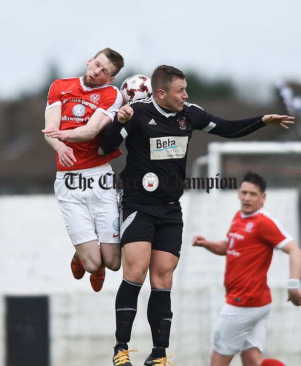 Colin Smyth of Newmarket Celtic in action against Shane Clarke of Janesboro during their Munster Junior Cup semi-final at Limerick. Photograph by John Kelly.