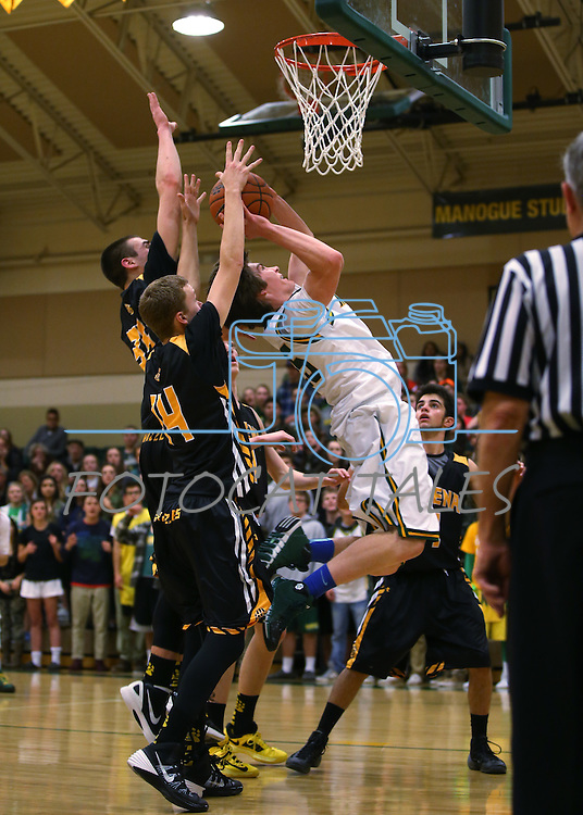 Manogue's Justin DeGeus tries to shoot under pressure from Galena defenders Zack Lessinger and Alex McClellan at Manogue High School in Reno, Nev., on Tuesday, Feb. 11, 2014. Manogue won 66-59.<br /> Photo by Cathleen Allison