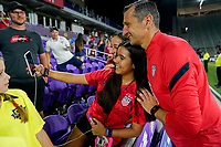 ORLANDO, FL - MARCH 05: USWNT headcoach Vlatko Andonovski takes a selfie with a fan during a game between England and USWNT at Exploria Stadium on March 05, 2020 in Orlando, Florida.