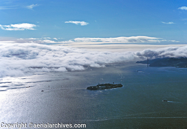 aerial photograph of Alctraz Island with fog at Golden Gate & part of the Marin headlands, San Francisco Bay
