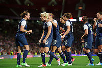 Manchester, England - Monday, August 5, 2012: The USA defeated Canada 4-3 in overtime in the semi-final round of the 2012 London Olympics at Old Trafford. Megan Rapinoe is congratulated after scoring by Kelley O'Hara.