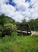 Franconia Notch bike path in Franconia Notch State Park, New Hampshire USA. Cannon Mountain can be seen in the background.