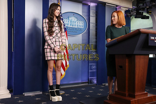 Jen Psaki, White House press secretary, introduces Olivia Rodrigo, during a news conference in the James S. Brady Press Briefing Room with Jen Psaki, White House press secretary, at the White House in Washington, D.C., U.S., on Wednesday, July 14, 2021. \<br /> CAP/MPI/RS<br /> ©RS/MPI/Capital Pictures