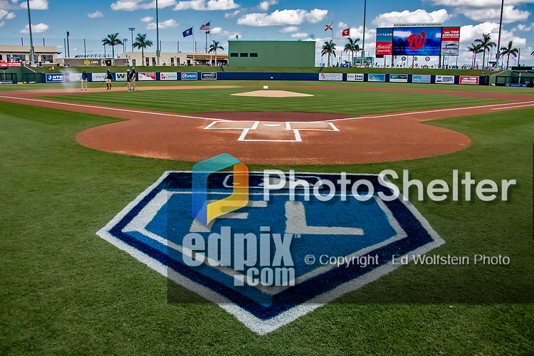 7 March 2019: The Grounds Crew waters down the infield turf prior to a Spring Training matchup between the New York Mets and the Washington Nationals at the Ballpark of the Palm Beaches in West Palm Beach, Florida. The Nationals defeated the visiting Mets 6-4 in Grapefruit League, pre-season play. Mandatory Credit: Ed Wolfstein Photo *** RAW (NEF) Image File Available ***