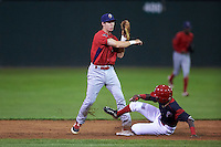 Williamsport Crosscutters second baseman Evan Rogers (38) throws to first base as Isaiah White slides in during a game against the Batavia Muckdogs on September 3, 2016 at Dwyer Stadium in Batavia, New York.  Williamsport defeated Batavia 10-0. (Mike Janes/Four Seam Images)