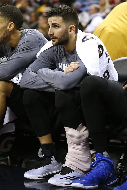 Minnesota Timberwolves guard Ricky Rubio sits on the bench during the first half of an NBA basketball game Tuesday, Jan. 19, 2016, in New Orleans. (AP Photo/Jonathan Bachman)