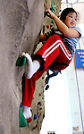 MIDDLEBURY, CT. 08 January  2006-010805SV01--Sarah Basset, 8, of Wolcott tries to hang on a rock wall while climbing it during the  Dorcas Society Fair at Westover School in Middlebury Sunday.<br /> Steven Valenti Republican-American<br /> (Sarah Basset, (cq))