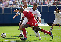 Panama's Jorge Luis Dely Valdes attempts to get by USA's Oguchi Onyewu. The United States defeated Panama 3-1 in a shoot out after a scoreless game to win the CONCACAF Gold Cup at Giant's Stadium, East Rutherford, NJ, on July 24, 2005.