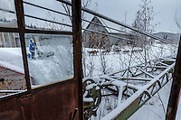 Paige Drobny runs past old mining equipment and cabins on her way to the Ophir Checkpoint on Thursday March 10 during Iditarod 2016.  Alaska.    <br /> <br /> Photo by Jeff Schultz (C) 2016  ALL RIGHTS RESERVED