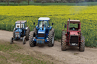 BNPS.co.uk (01202) 558833. <br /> Pic: Cheffins/BNPS<br /> <br /> Pictured: A Ford 7000 sold for £34,840, 1983 County 1474 £210,112 and a 1974 Massey Ferguson 1200 sold for 27,872. <br /> The top selling lot was a 1983 County 1474 (PICTURED CENTRE) which has done less than 100 hours in the past 25 years. It fetched £210,100<br /> <br /> A farming family is today celebrating after their incredible collection of almost 100 vintage tractors sold for a staggering £1million.<br /> <br /> Father and son duo Ian and Martin Liddell began hoarding the agricultural vehicles at their arable farm in the 1980s.<br /> <br /> Their fleet of tractors was so large that they had to be stored in three barns.<br /> <br /> The prized collection sparked a worldwide bidding war when it was sold with auctioneers Cheffins, of Cambridge, after the family decided to part with the tractors to free up space on their Essex farm to pursue other projects.