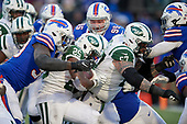 New York Jets running back Elijah McGuire (25) is tackled by Ramon Humber (50) during an NFL football game against the Buffalo Bills, Sunday, December 9, 2018, in Orchard Park, N.Y.  (Mike Janes Photography)