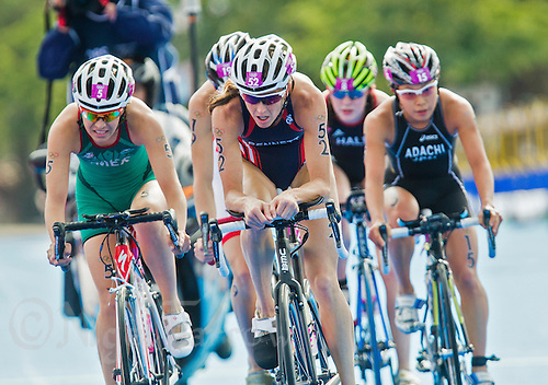 04 AUG 2012 - LONDON, GBR - Laura Bennett (USA) of the USA (second from left) leads the front pack during the bike at the women's London 2012 Olympic Games Triathlon in Hyde Park, London, Great Britain (PHOTO (C) 2012 NIGEL FARROW)