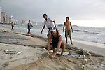 Fishermen pull in their nets in the late afternoon on the beach at Balneario Camboriu, Santa Catarina, Brazil