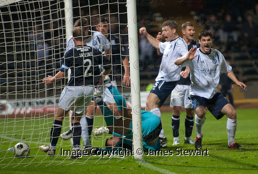 Forfar player bundle the ball into the net but the goal was disallowed by Referee Crawford Allan.