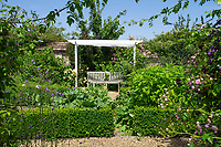 BNPS.co.uk (01202 558833)<br /> Pic: Hamptons/BNPS<br /> <br /> Pictured: The gardens.<br /> <br /> An incredible Arts and Crafts country house with its own vineyard is on the market for offers over £7m.<br /> <br /> The Grade II listed St Joseph's Hall is a striking 111-year-old property that was home to the Bishop of Arundel for 40 years.<br /> <br /> It has a wealth of period features, an indoor swimming pool and seven acres of vineyard with mostly Chardonnay grapes, which the owners sell to a local winery.<br /> <br /> The house in Storrington, West Sussex, has 17 acres of land with beautiful views over the South Downs.