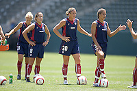 Shannon MacMillan, Abby Wambach and Shannon Boxx await their turn to take a shot on goal. The USA defeated Iceland, 3-0, at the Home Depot Center in Carson, CA on July 24, 2005.