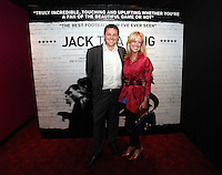 """Pictured: Vide chairman Leigh Dineen with his wife. Friday 12 September 2014<br /> Re: Premiere of """"Jack To A King"""" a film about the history of Swansea City Football Club, at The Empire Cinema in Leicester Square, London, UK."""