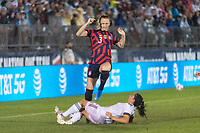 EAST HARTFORD, CT - JULY 1: Samantha Mewis #3 of the United States jumps over a tackle by Jimena Lopez #5 of Mexico during a game between Mexico and USWNT at Rentschler Field on July 1, 2021 in East Hartford, Connecticut.