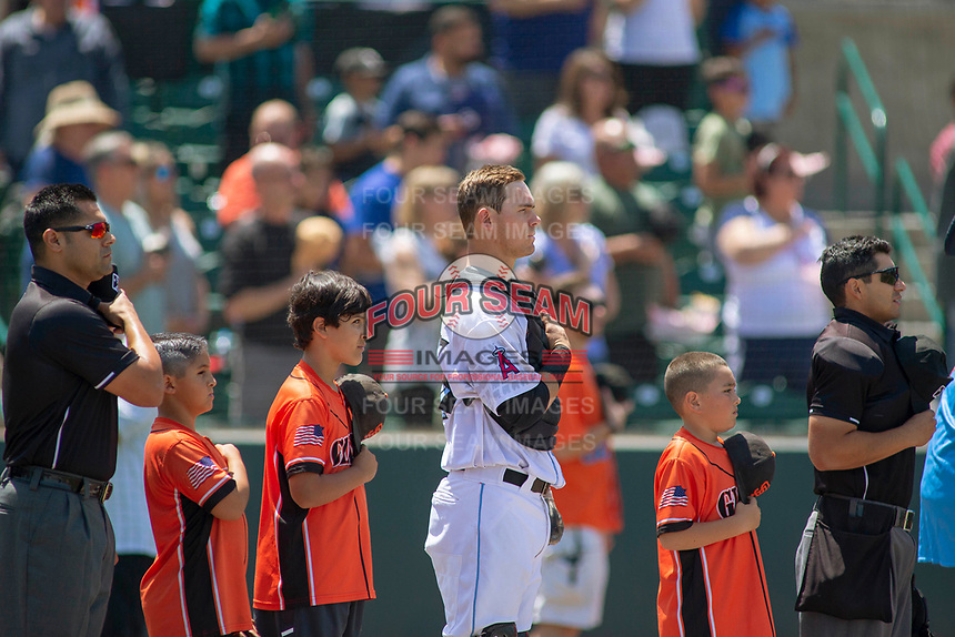 Inland Empire 66ers Jack Kruger (27) and young fans on the field during the national anthem before the game against the Rancho Cucamonga Quakes at San Manuel Stadium on May 27, 2018 in San Bernardino, California. The Quakes defeated the 66ers 8-2. (Donn Parris/Four Seam Images)