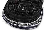 Car Stock 2017 BMW 7 Series 740i 4 Door Sedan Engine  high angle detail view