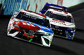 CONCORD, NORTH CAROLINA - MAY 24: Kyle Busch, driver of the #18 M&M's Red White Blue Toyota, leads Daniel Suarez, driver of the #96 Today.Tomorrow.Toyota Toyota, during the NASCAR Cup Series Coca-Cola 600 at Charlotte Motor Speedway on May 24, 2020 in Concord, North Carolina. (Photo by Jared C. Tilton/Getty Images)