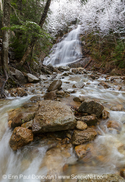 Cloudland Falls along Dry Brook in Franconia Notch of the New Hampshire White Mountains after a dusting of snow during the spring months. The Falling Waters Trail passes by this scenic waterfall.