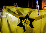 Israeli Right wing activists wave the flag of the outlawed terror organization and movement Kach during an Israeli left wing protest and march in Jerusalem Saturday Oct. 17 2015. Photo by Eyal Warshavsky.