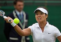 27-06-13, England, London,  AELTC, Wimbledon, Tennis, Wimbledon 2013, Day four, Na Li (CHN)<br /> <br /> <br /> <br /> Photo: Henk Koster