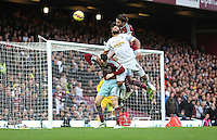 Sunday 07 December 2014<br /> Pictured: Ashley Williams of Swansea (C) jumps for a header against Andy Carroll of West Ham (above him)<br /> Re: Premier League West Ham United v Swansea City FC at Boleyn Ground, London, UK.