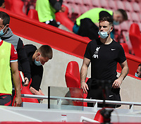 24th April 2021; Anfield, Liverpool, Merseyside, England; English Premier League Football, Liverpool versus Newcastle United; injured Liverpool club captain Jordan Henderson walks from the dugout at half time