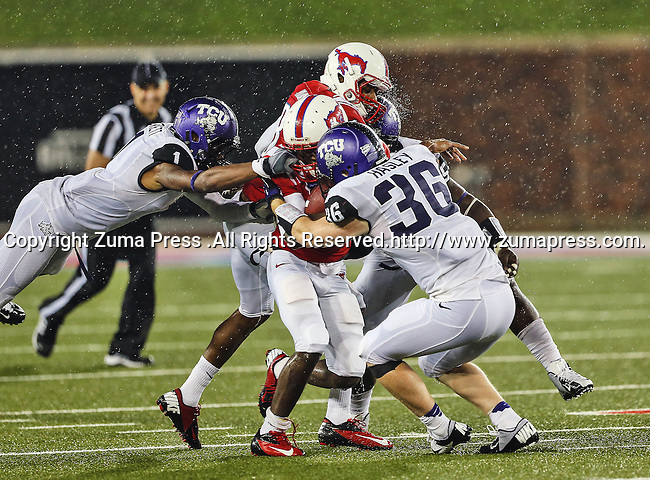 TCU Horned Frogs safety Chris Hackett (1), TCU Horned Frogs linebacker Joel Hasley (36), Southern Methodist Mustangs wide receiver Keenan Holman (81) and Southern Methodist Mustangs wide receiver Jeremy Johnson (15) in action during heavy rainfall in the game between the Southern Methodist Mustangs and the TCU Horned Frogs at the Gerald J. Ford Stadium in Dallas, Texas. TCU defeats SMU 24 to 16..