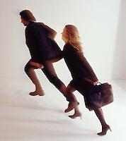 Man & woman couple holding hands running
