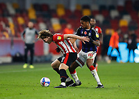 7th November 2020; Brentford Community Stadium, London, England; English Football League Championship Football, Brentford FC versus Middlesbrough; Chuba Akpom of Middlesbrough challenges Mads Bech Sorensen of Brentford