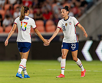 HOUSTON, TX - JUNE 10: Alex Morgan #13 of the USWNT shakes hands with Christen Press #23 during a game between Portugal and USWNT at BBVA Stadium on June 10, 2021 in Houston, Texas.