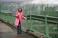 asian woman with umbrella enjoying break in the rain..MR