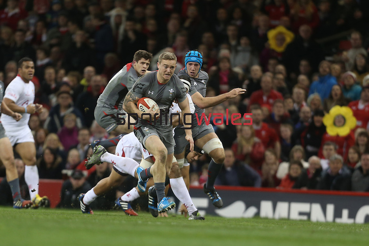Wales center Owen Williams bursts through the Tongan defence to score the first try of the match.<br /> <br /> Dove Men Series 2013<br /> Wales v Tonga<br /> Millennium Stadium - Cardiff<br /> 22.11.13<br /> ©Steve Pope-SPORTINGWALES
