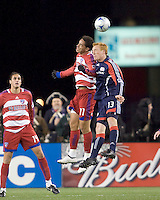 FC Dallas midfielder Andre Rocha (11) and New England Revolution midfielder/defender Jeff Larentowicz (13) battle for a head ball. The New England Revolution defeated FC Dallas, 2-1, at Gillette Stadium on April 4, 2009. Photo by Andrew Katsampes /isiphotos.com