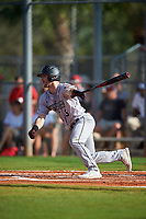 Northeastern Huskies right fielder Jeff Costello (5) bats during a game against the South Dakota State Jackrabbits on February 23, 2019 at North Charlotte Regional Park in Port Charlotte, Florida.  Northeastern defeated South Dakota State 12-9.  (Mike Janes/Four Seam Images)
