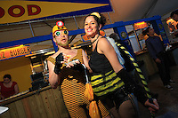 Pollination week in New York started with a costume ball on June 22, 2009. A couple of bees out for a good time eat a hot-dog covered in honey-flavored mustard. Forbidden beekeeping is underground…but so chic…