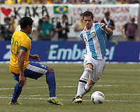 Argentina midfielder Fernando Gago (5) dribbles as Brazil forward Hulk (20) defends. In an international friendly (Clash of Titans), Argentina defeated Brazil, 4-3, at MetLife Stadium on June 9, 2012.
