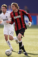 The MetroStars' Eddie Gaven is shadowed by Danny O'Rourke of the EarthQuakes. The San Jose EarthQuakes defeated the MetroStars 1 - 0 at Giant's Stadium, East Rutherford, NJ, on Saturday May 7, 2005.