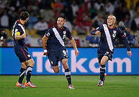 Clint Dempsey (center) of USA celebrates his goal with teammates. USA vs England in the 2010 FIFA World Cup at Royal Bafokeng Stadium in Rustenburg, South Africa on June 12, 2010.