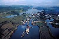 Container ships transit the Panama Canal, aerial view. Panama.
