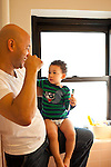 Toddler boy age 18 months at home with father in bathroom learning how to brush teeth