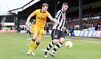 Richard Duffy of Notts County is closely marked by Ryan Bird of Newport County during the Sky Bet League Two match between Newport County and Notts County at Rodney Parade, Newport, Wales, UK. Saturday 06 May 2017