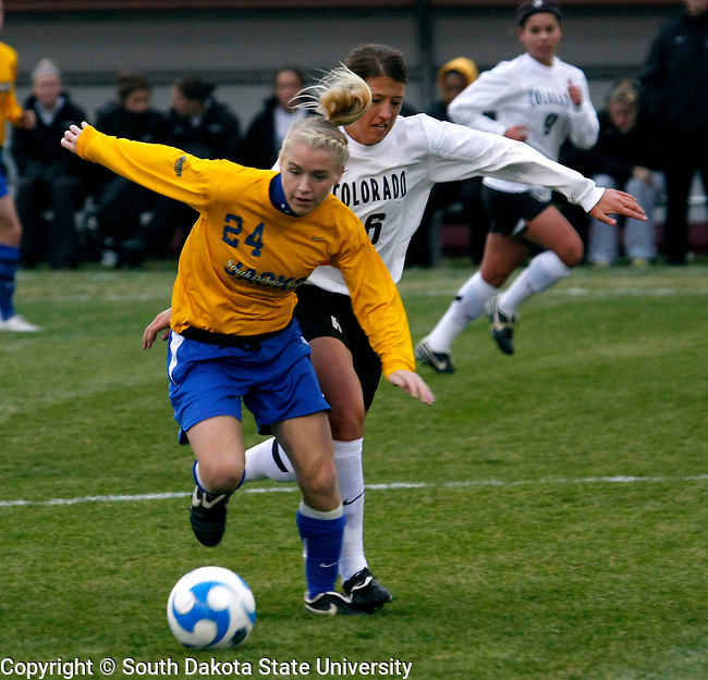 South Dakota State's Danni Healy is able to keep control of the ball despite the defense of  Nikki Keller of Colorado University during their first round 2008 Division 1 Soccer Championship game at Elizabeth Lyle Robbis Stadium on the campus of the University of Minnesota in St. Paul, MN. (Photo By Ty Carlson/Inertia)