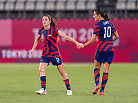 KASHIMA, JAPAN - AUGUST 5: Kelley O'Hara #5 shakes hands with Carli Lloyd #10 of the USWNT during a game between Australia and USWNT at Kashima Soccer Stadium on August 5, 2021 in Kashima, Japan.