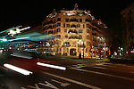 A bus passes at night in front of Gaudi's La Casa Mila in Barcelona, Spain. Feb. 19, 2009.