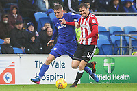 Danny Ward of Cardiff City challenges Andreas Bjelland of Brentford during the Sky Bet Championship match between Cardiff City and Brentford at the Cardiff City Stadium, Wales, UK. Saturday 18 November 2017