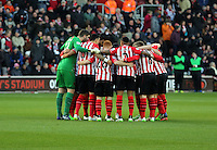 Pictured: Southampton players huddle before kick off Sunday 01 February 2015<br />